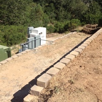 Schramsberg retaining wall for ground mount on steep hillside